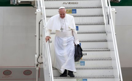 Pope Francis steps off a plane after returning from his trip to Brazil at Ciampino airport