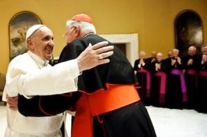 Pope Francis embraces Cardinal Cormac Murphy-O'Connor (Mazur)